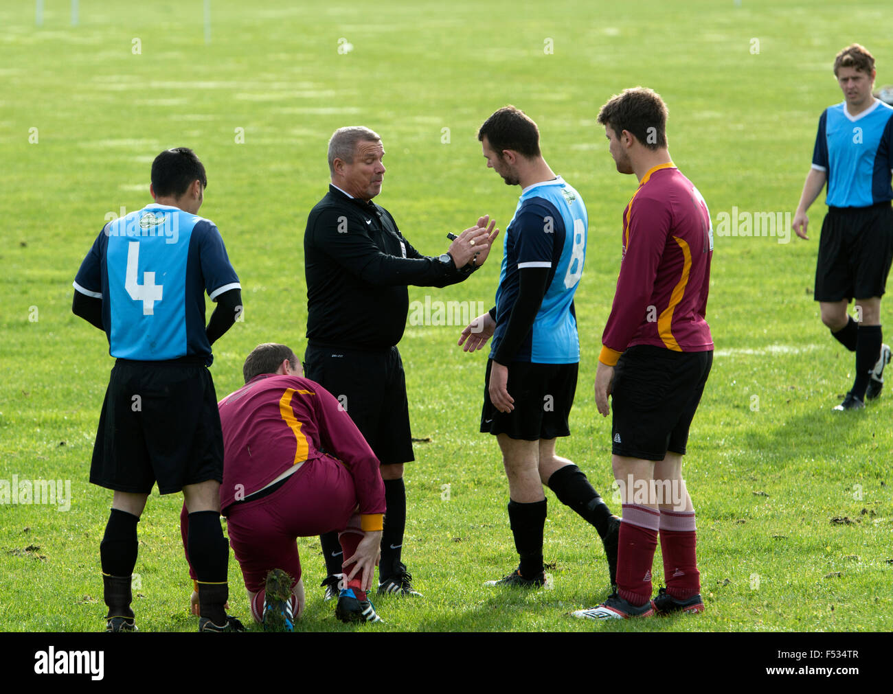 Sunday League football, referee talking to a player - Stock Image