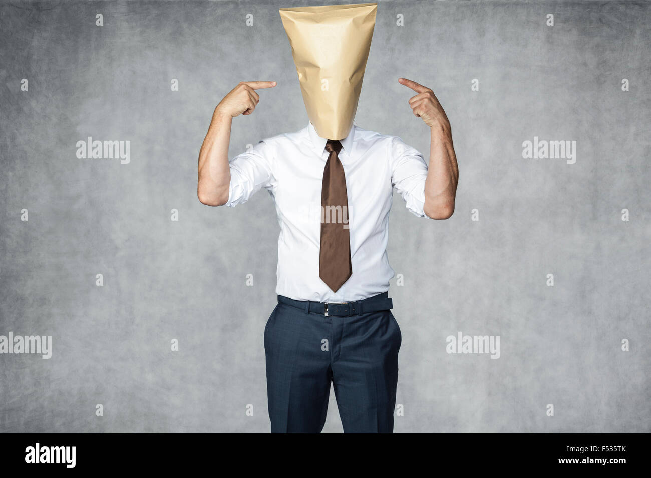 incognito businessman pointing on his one face everyone can by