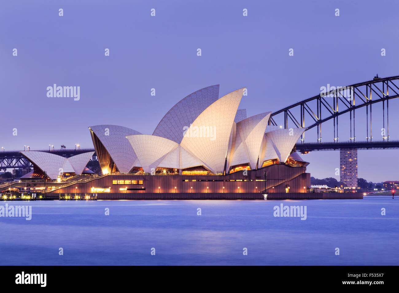 SYDNEY, AUSTRALIA, 10 JULY 2015 - Sydney opera house and Harbour bridge in Sydney at sunset. Iconic and world famous Stock Photo