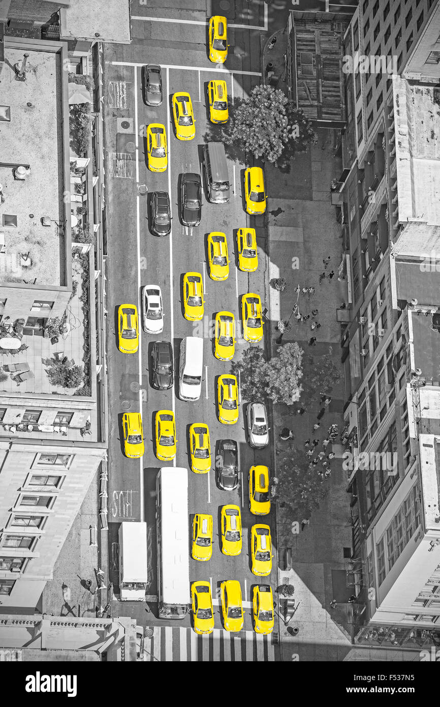 Old film style photo of New York taxis from above, black and white picture with yellow cabs in Manhattan, USA. - Stock Image