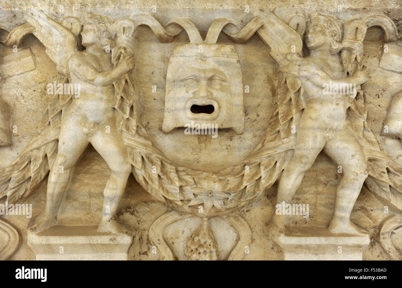 Garland sarcophagus. Marble. Tel Mevorah. Roman period, 3rd century CE. Detail. The open-mouthed mask indicates - Stock Image