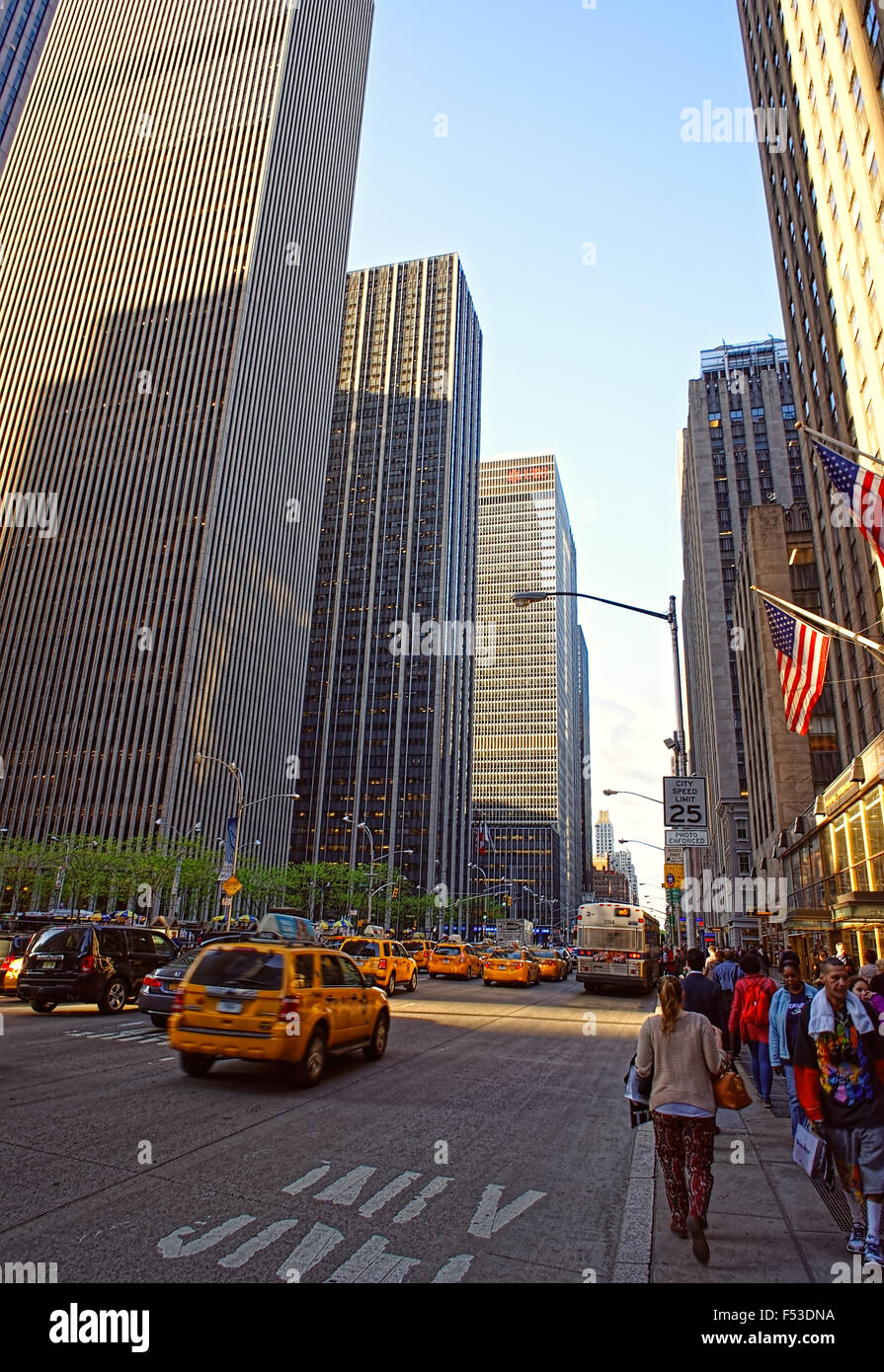 NEW YORK, USA - MAY 07, 2015: Typical Manhattan scenery with yellow cabs speeding through busy street of New York - Stock Image