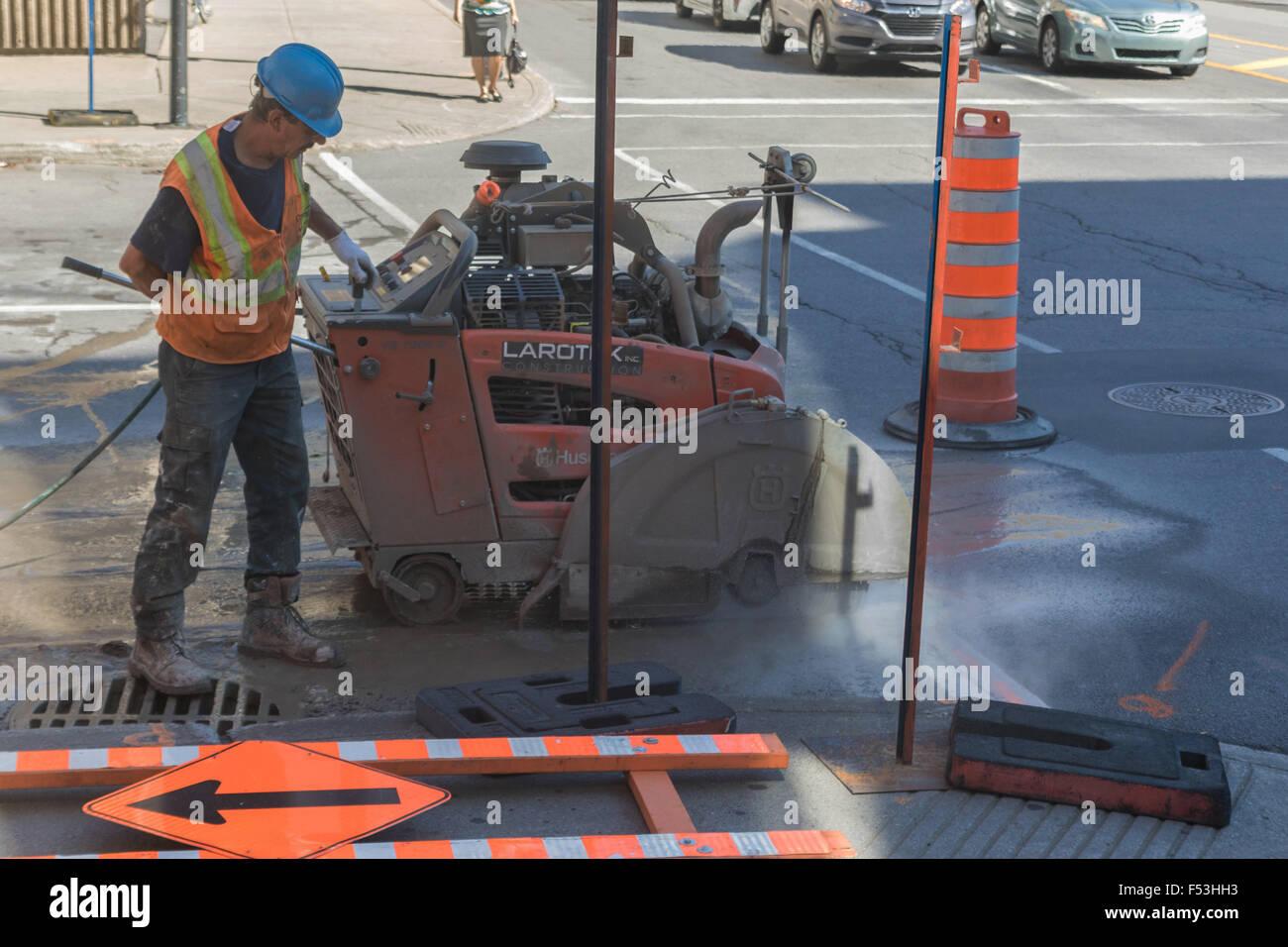 An Asphalt Zipper pulverizing asphalt and injecting water through a spray  bar to repair a surface