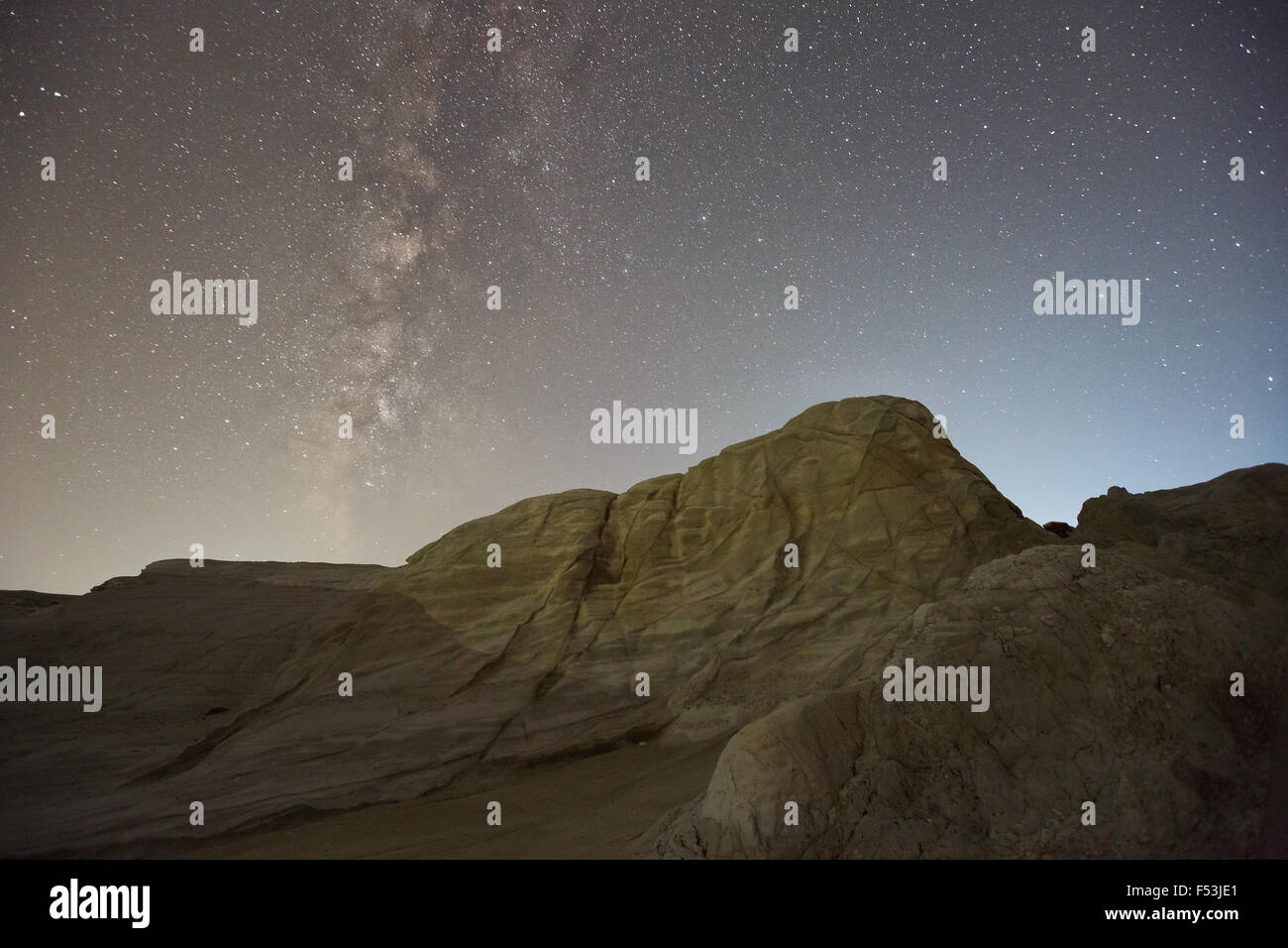 Night photograph of volcanic rock formations nearby Sarakiniko beach in the north of Milos island, Greece. - Stock Image
