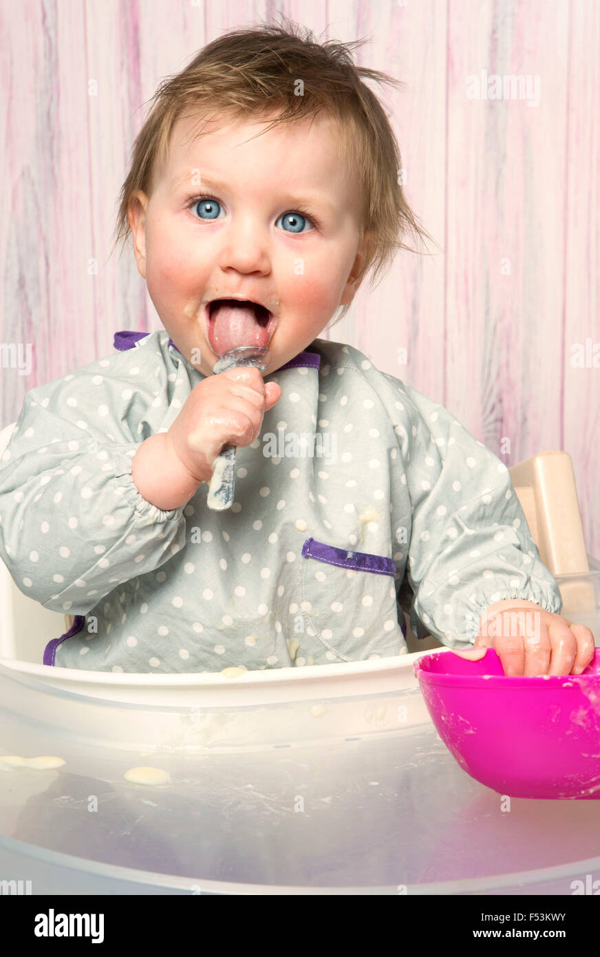 Baby, 6-12 months, mash, food, spoon, solid food, high chair, studio, portrait, - Stock Image
