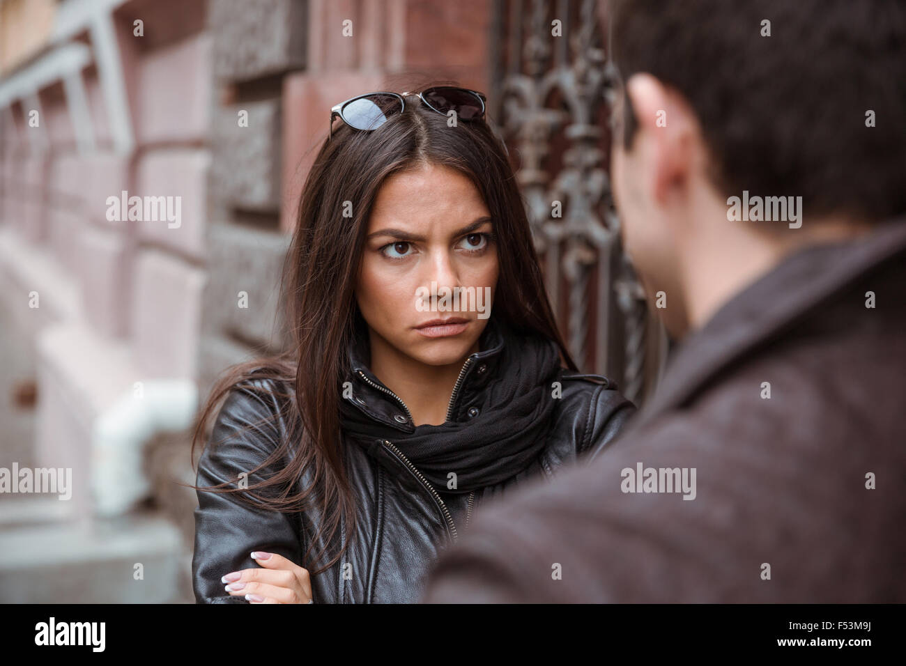 Young couple having an argument outdoors - Stock Image