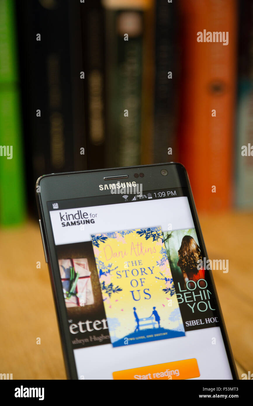 View Of The Kindle Store On A Samsung Smartphone Against Traditional Bookshelf