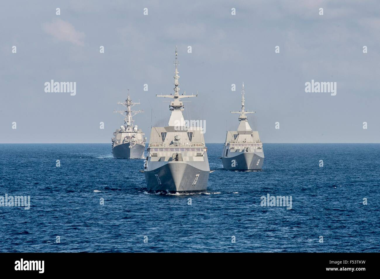 The Republic of Singapore Navy's RSS Intrepid, right, RSS Supreme, center, and the Arleigh Burke-class guided - Stock Image