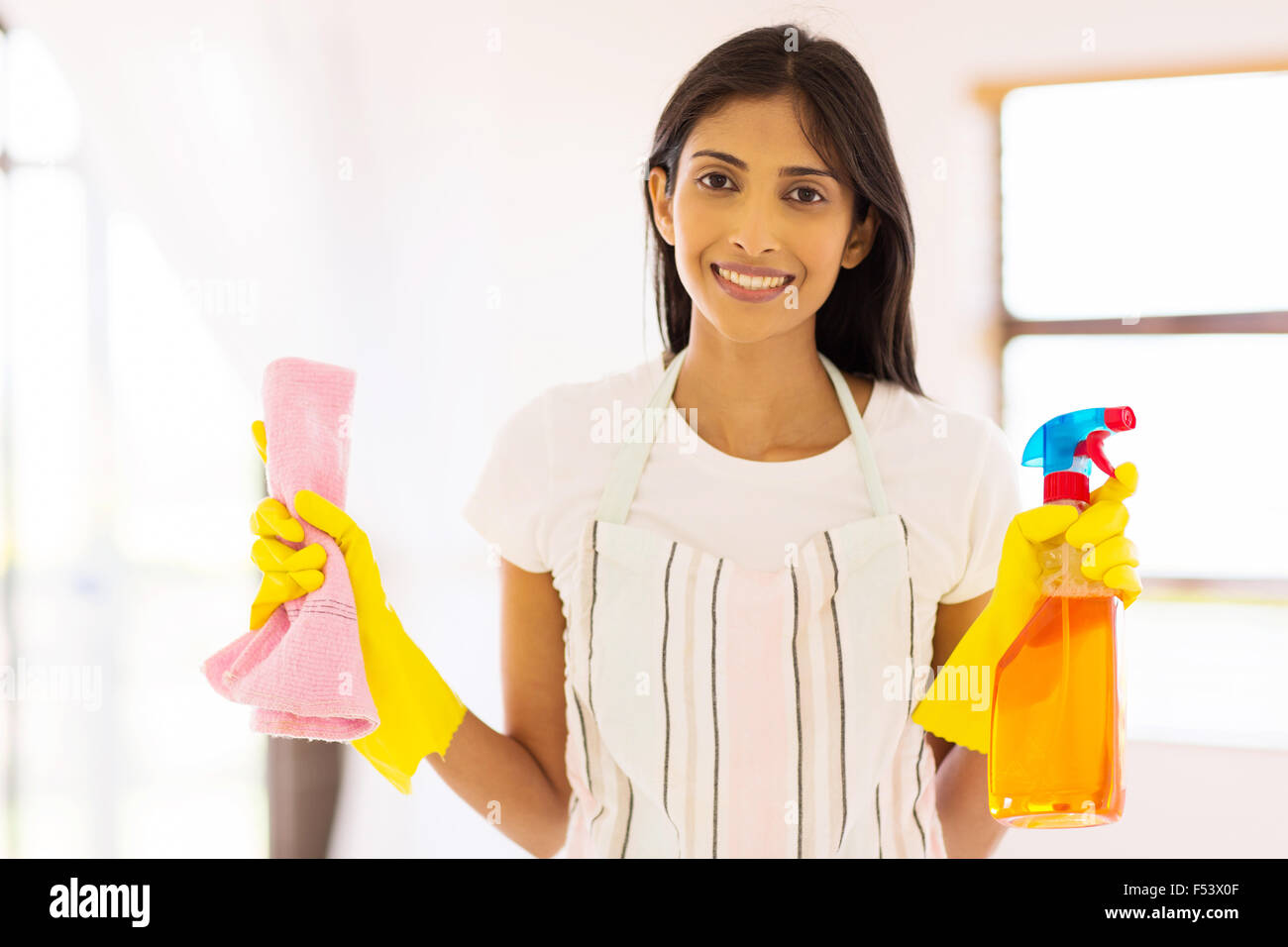 pretty Indian housewife doing housework - Stock Image