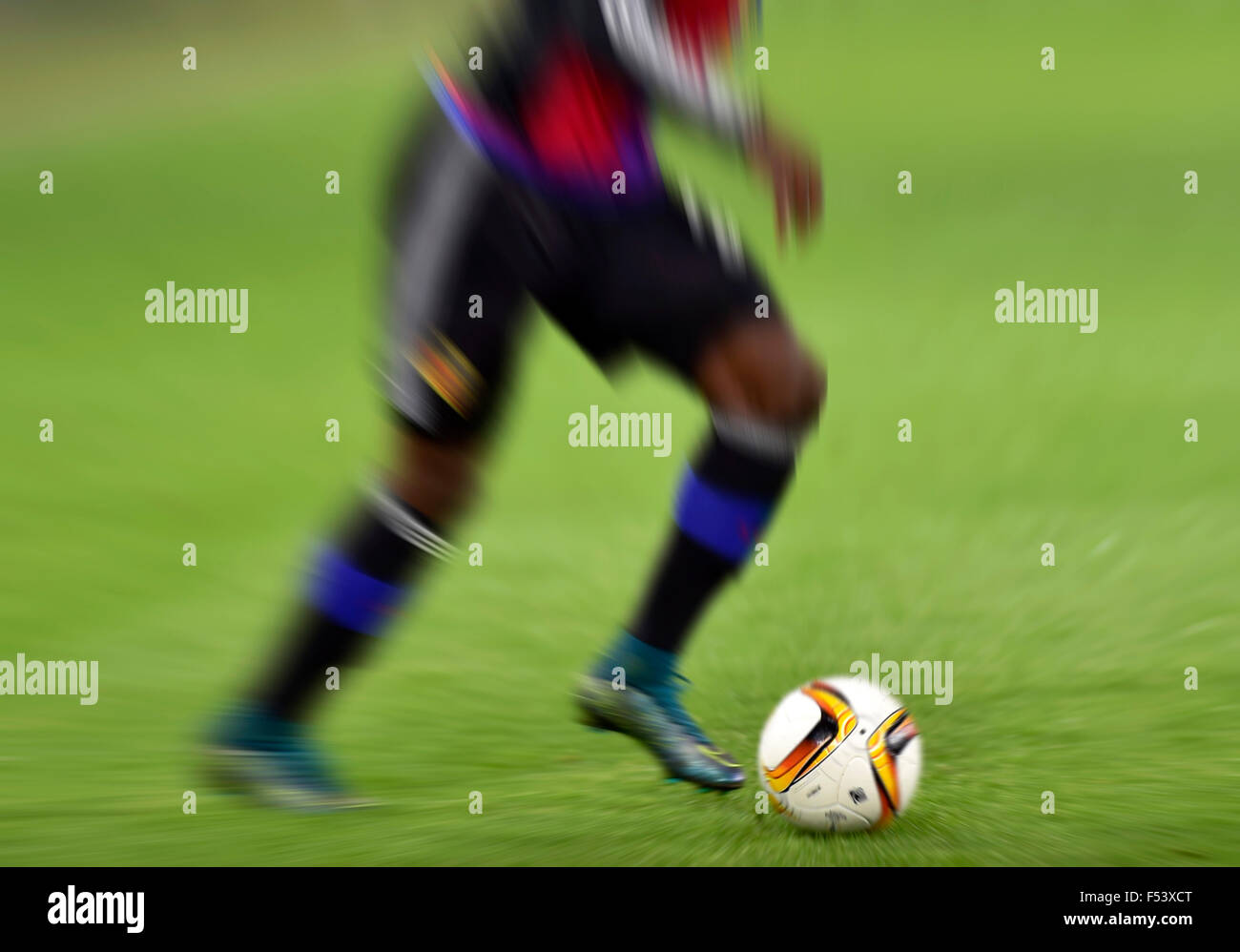 Football and the legs of a soccer player, zoomed, Basel, Switzerland - Stock Image