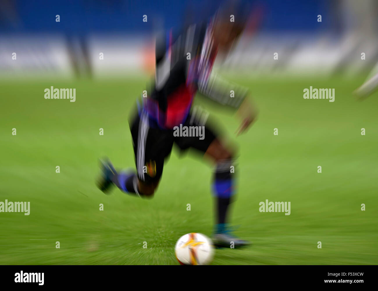 Football player with the ball, in action, zoomed, Basel, Switzerland - Stock Image