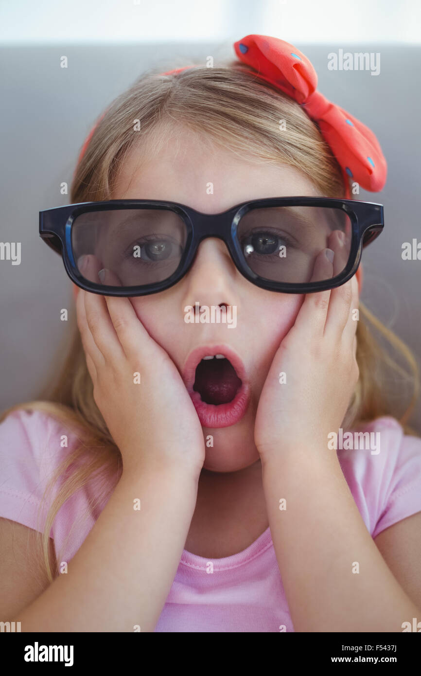 close up of a girl wearing 3d glasses for a moive stock photo
