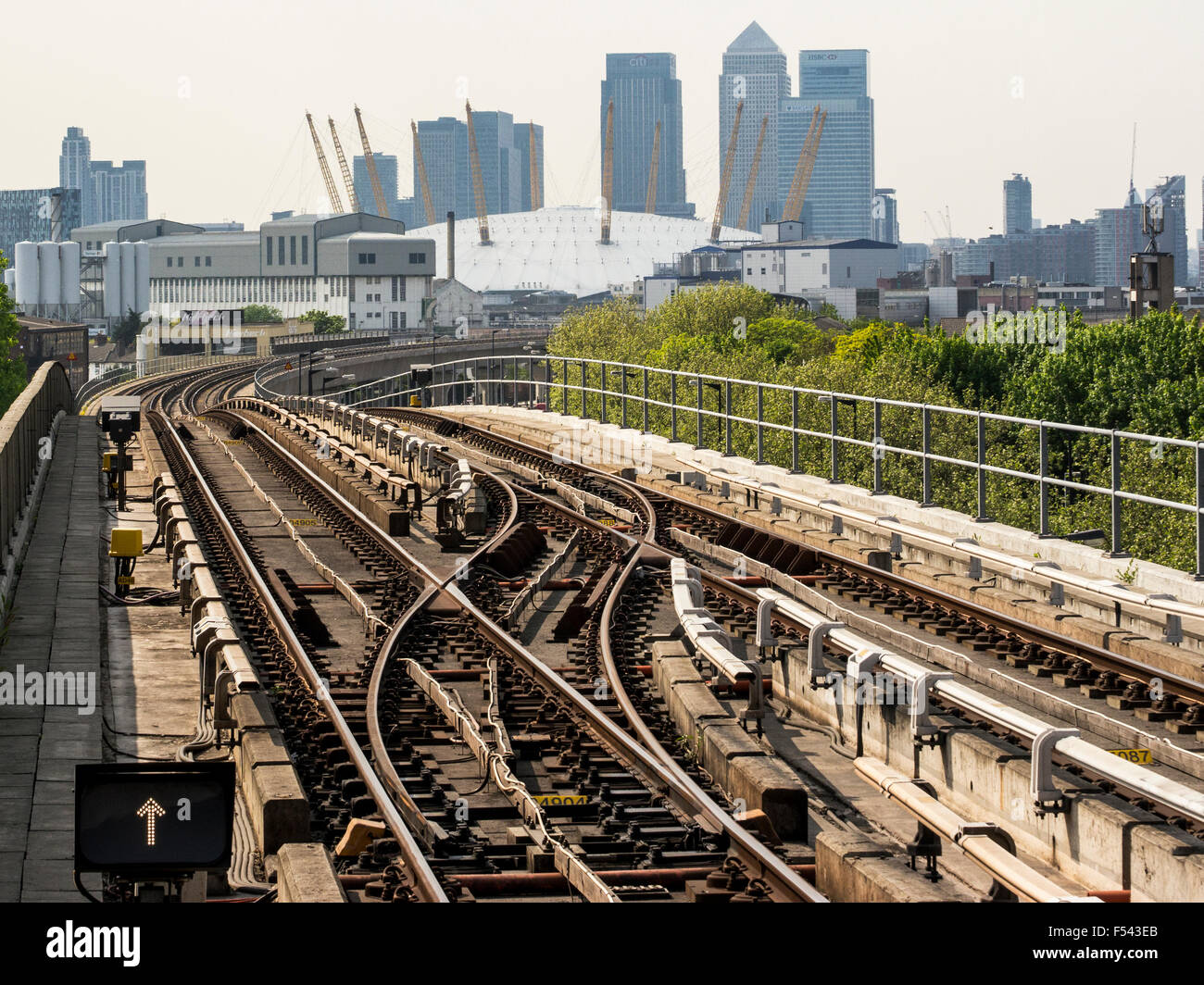 Dockland Light Railway tracks heading towards Canary Wharf and the City with the O2 centre in the foreground - Stock Image