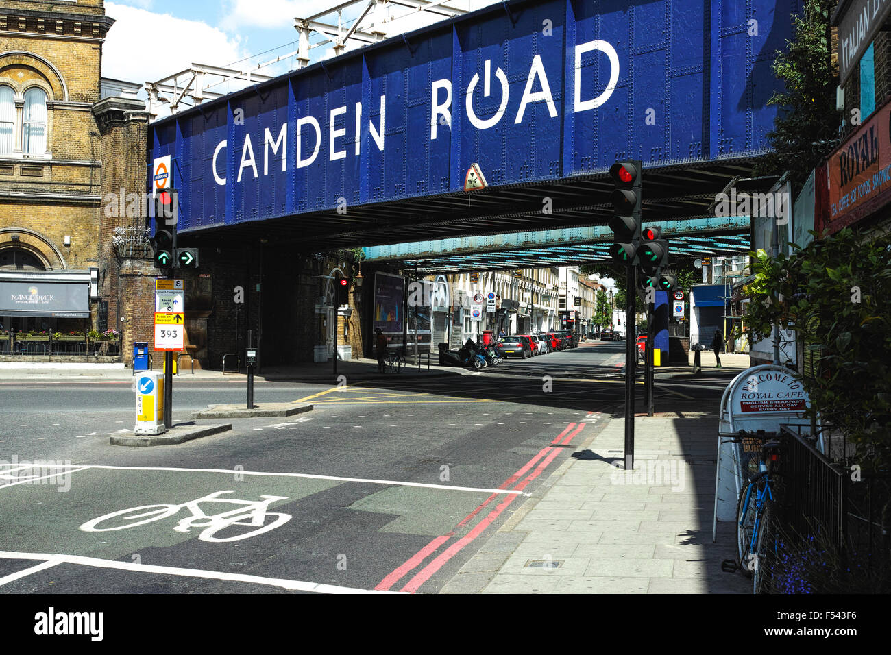 Camden Road showing the London Overground railway bridge repainted with location - Stock Image