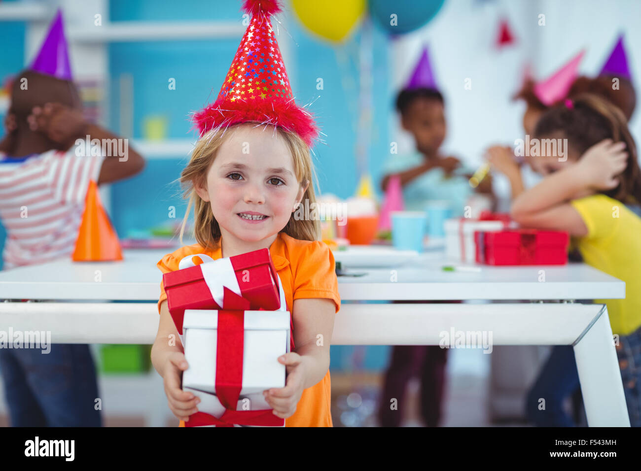 Smiling girl at birthday party - Stock Image
