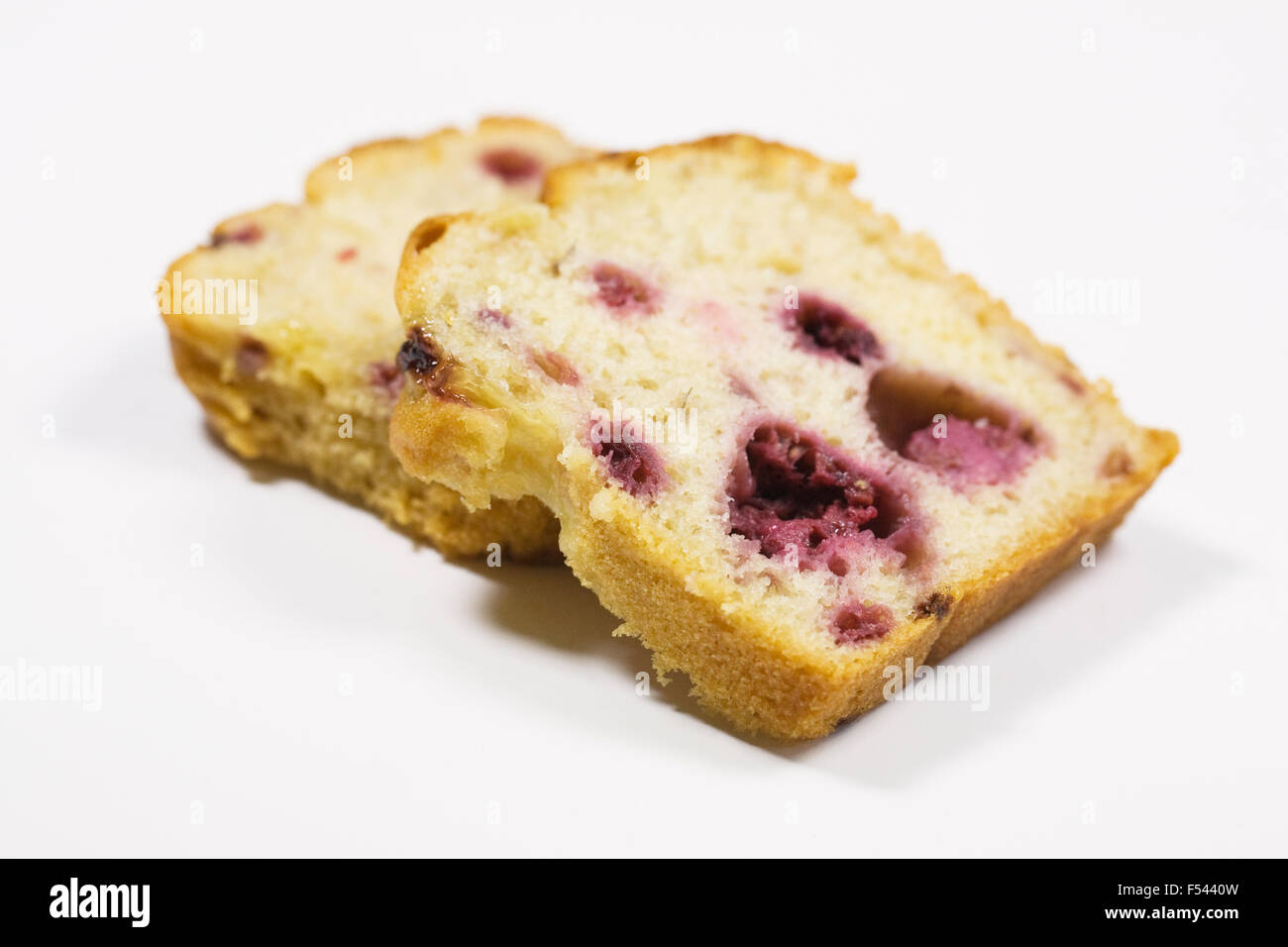 Two slices of homemade raspberry and lemon loaf cake. - Stock Image