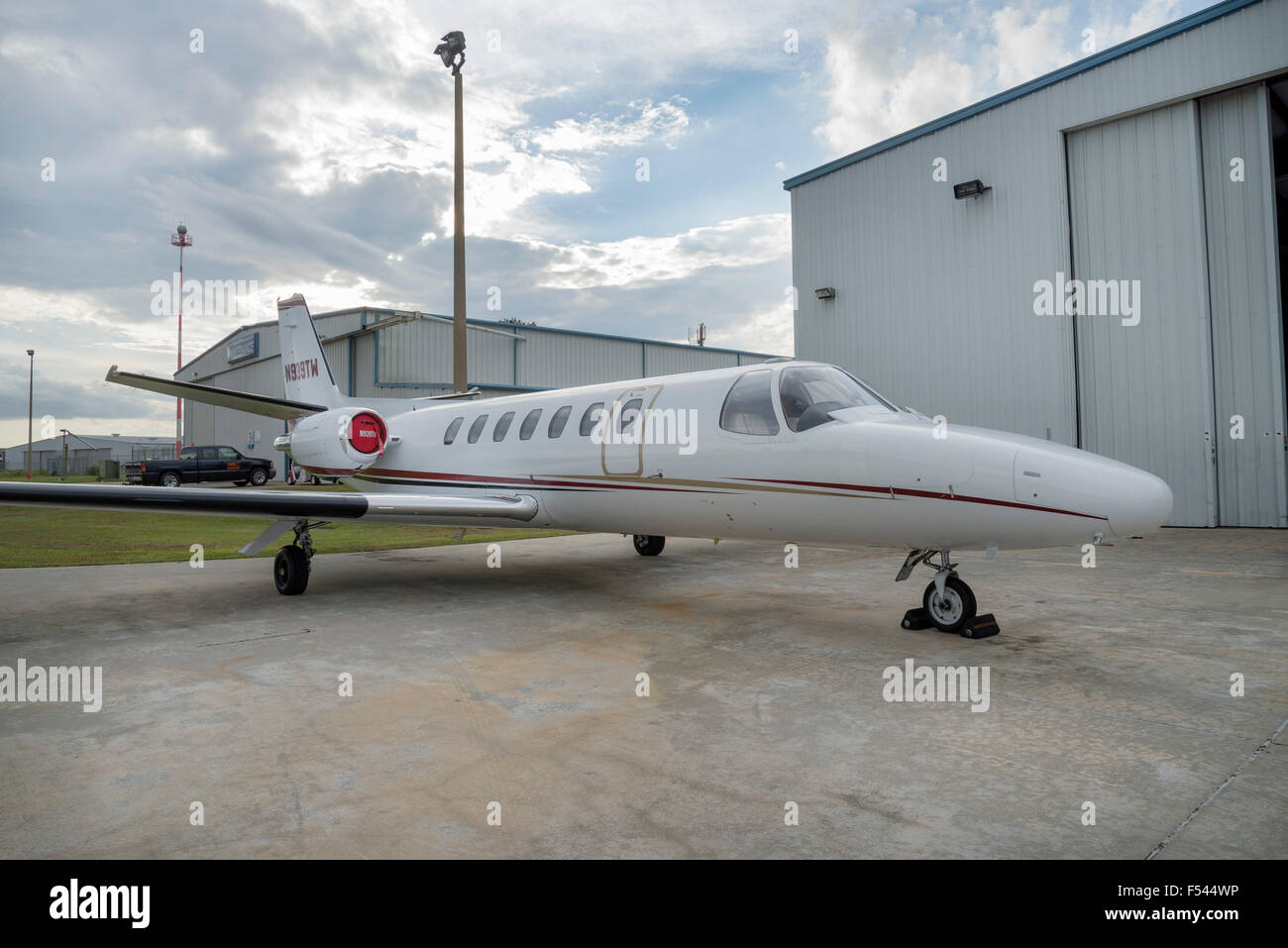 A small jet aircraft parked at a local general aviation air service airport in Gainesville, Florida. - Stock Image