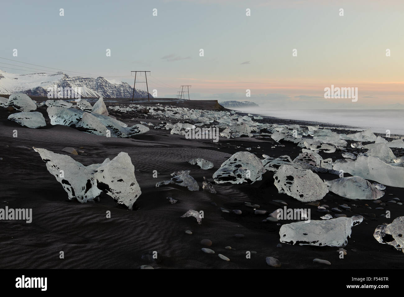 Ice bergs washed up on the black sand beach of Breiðamerkursandur, on the south coast of Iceland. - Stock Image