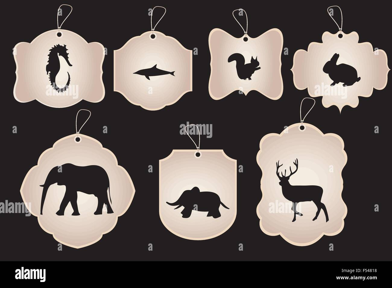 Vintage stickers in various forms with silhouettes of animals isolated on black - Stock Image