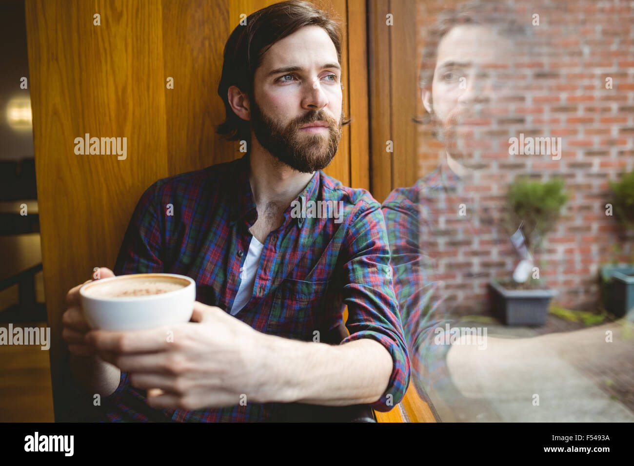 Hipster student having coffee in canteen - Stock Image