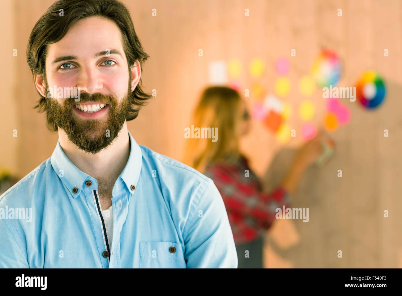 Creative man smiling at camera Stock Photo