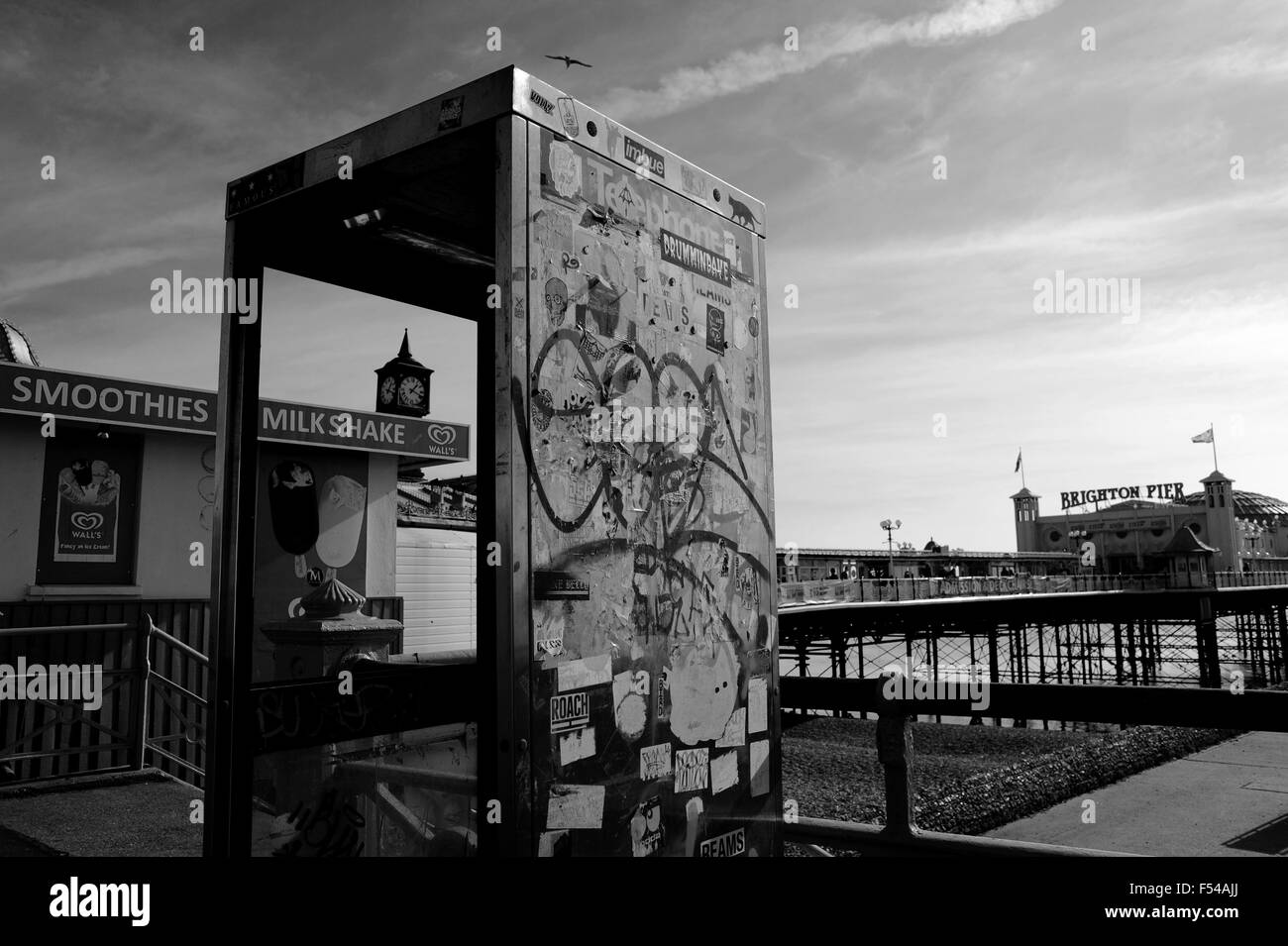 Derelict BT telephone box on Brighton seafront by Brighton Pier formerly The Palace Pier Sussex UK - Stock Image