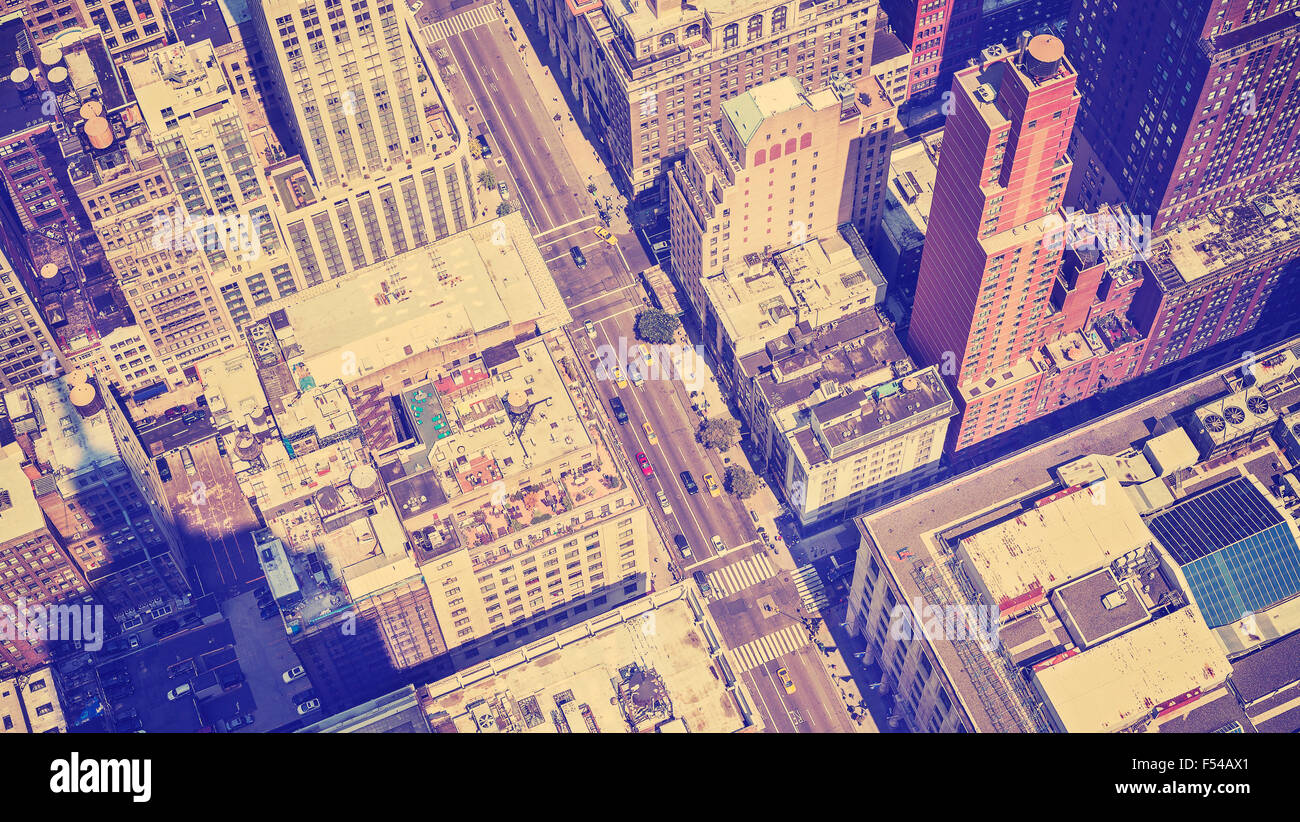 Vintage style aerial picture of Manhattan street with shadow of the Empire State Building, New York, USA. - Stock Image