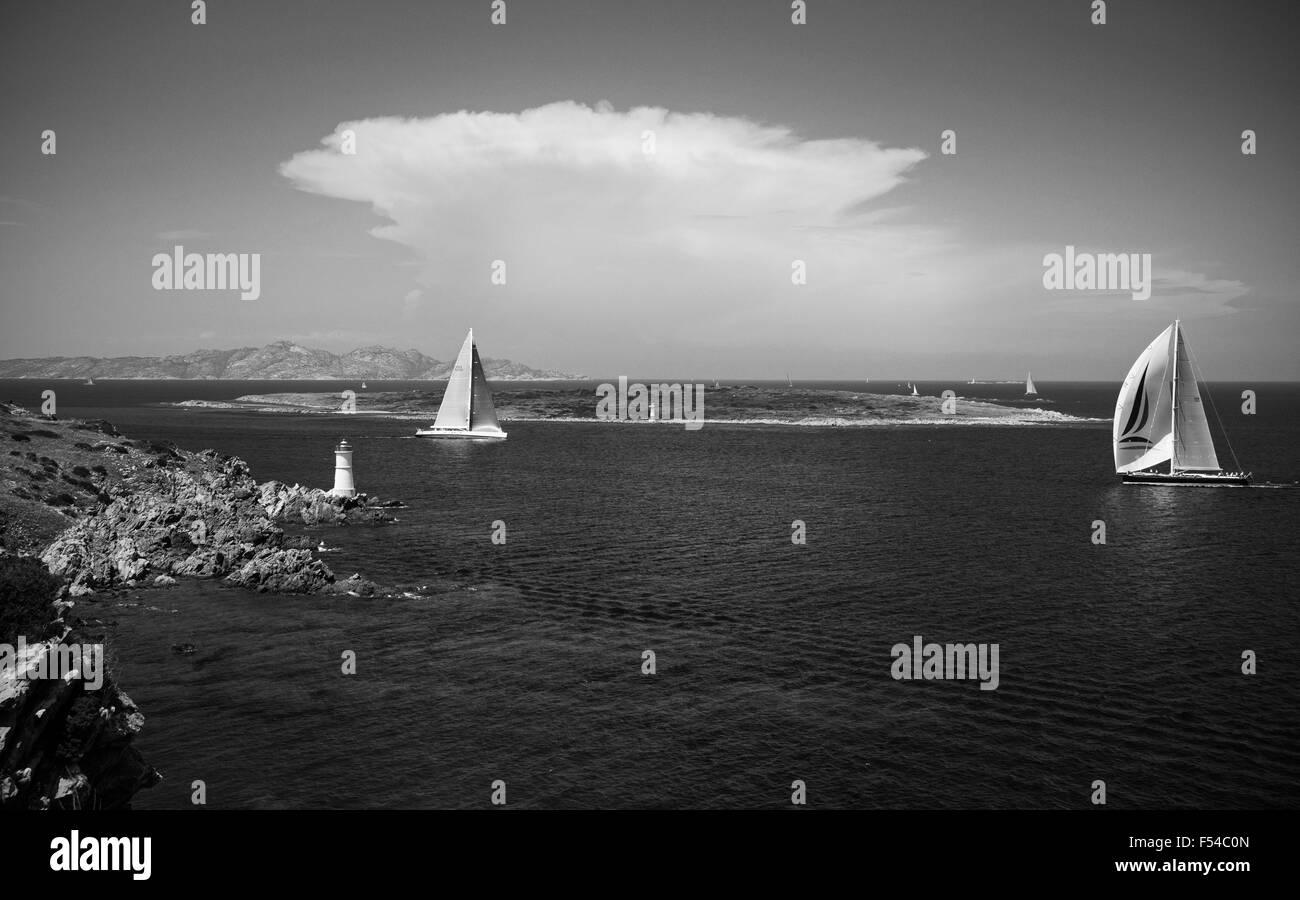 Emerald coast,Sardinia,Italy,5/2015. Yacht sailing along the coast near Porto Cervo, Arzachena, Gallura,on a hot - Stock Image