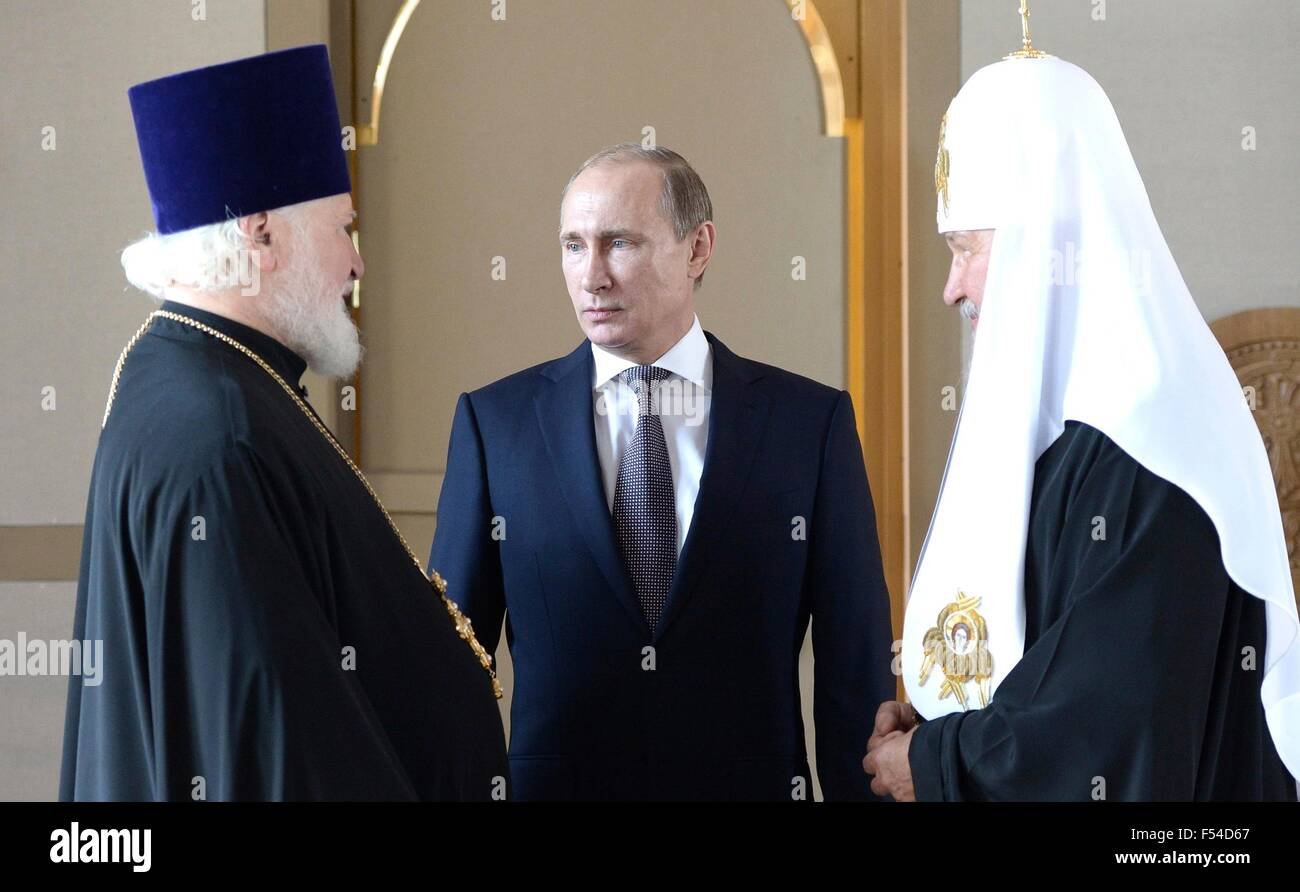 Russian President Vladimir Putin with Patriarch of Moscow and All Russia Kirill (right) and Rector of the Orthodox - Stock Image