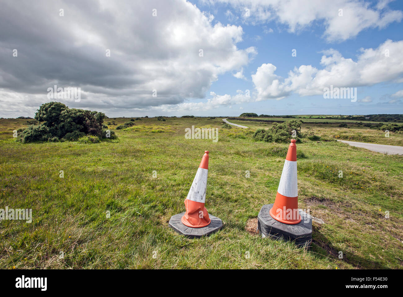 road work cones red and white,grass on Bodmin Moor Cornwall - Stock Image