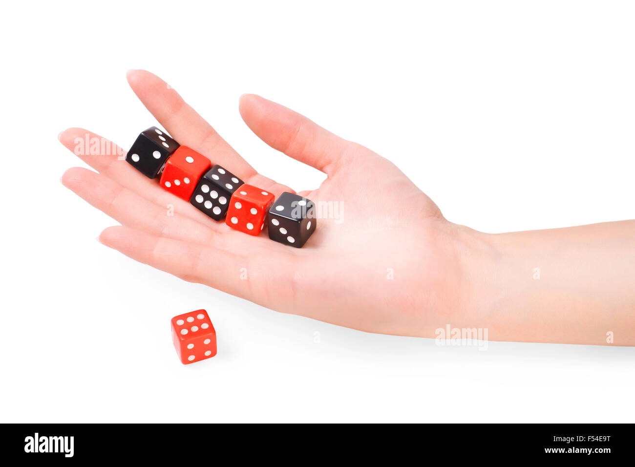 Female hand with dices isolated on white with clipping path Stock Photo