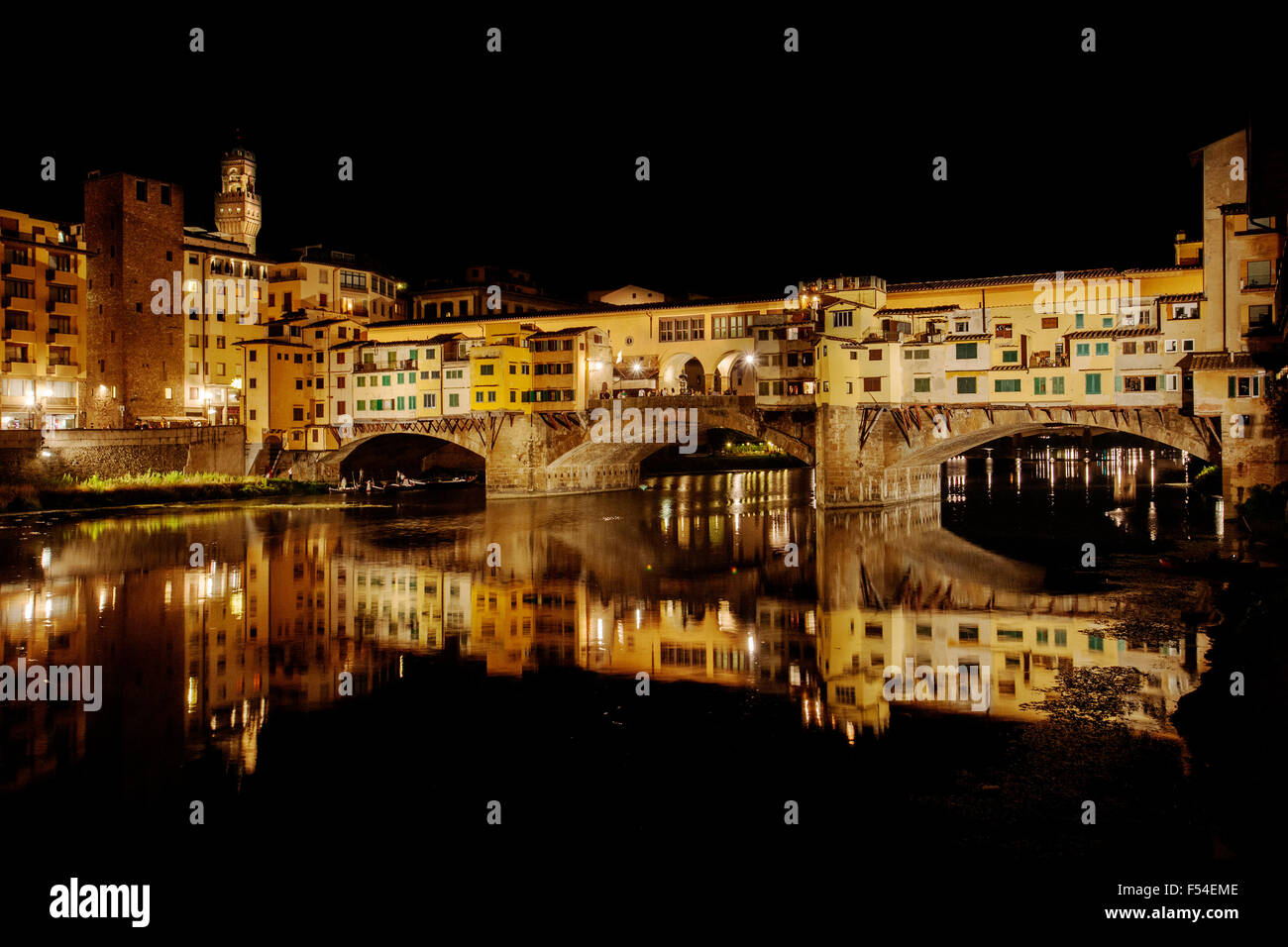 Ponte Vecchio, Old Bridge, Taddeo Gaddi, over Arno river in Florence  Italy at night - Stock Image