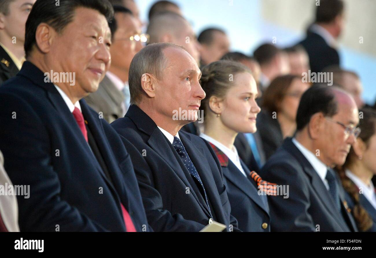 Russian President Vladimir Putin sits with Chinese President  Xi Jinping during a gala celebrating the 70th anniversary - Stock Image