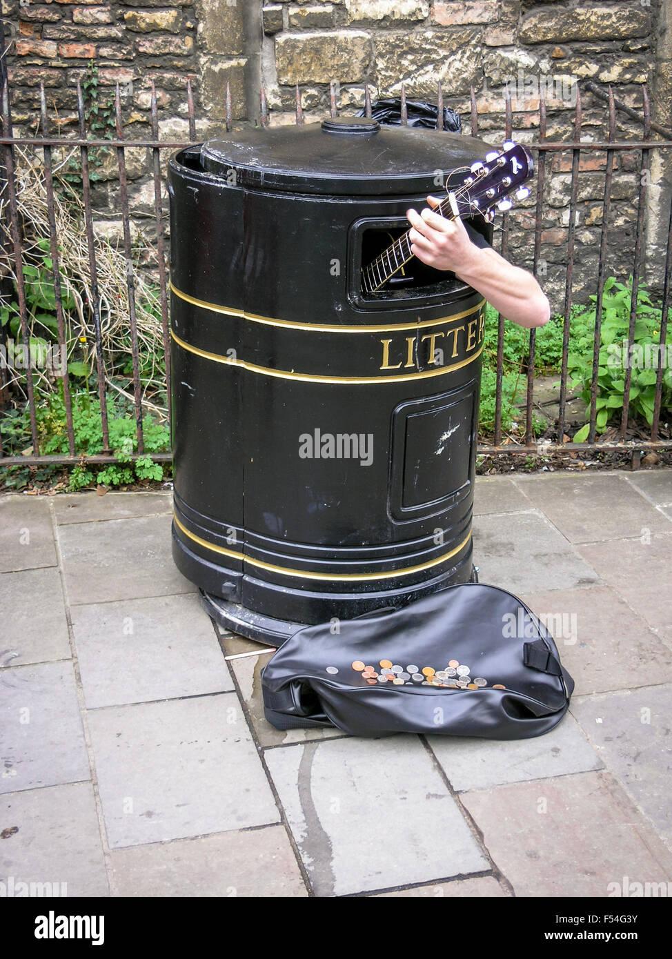 Busker sings in a litter bin, Cambridge, United Kingdom Stock Photo