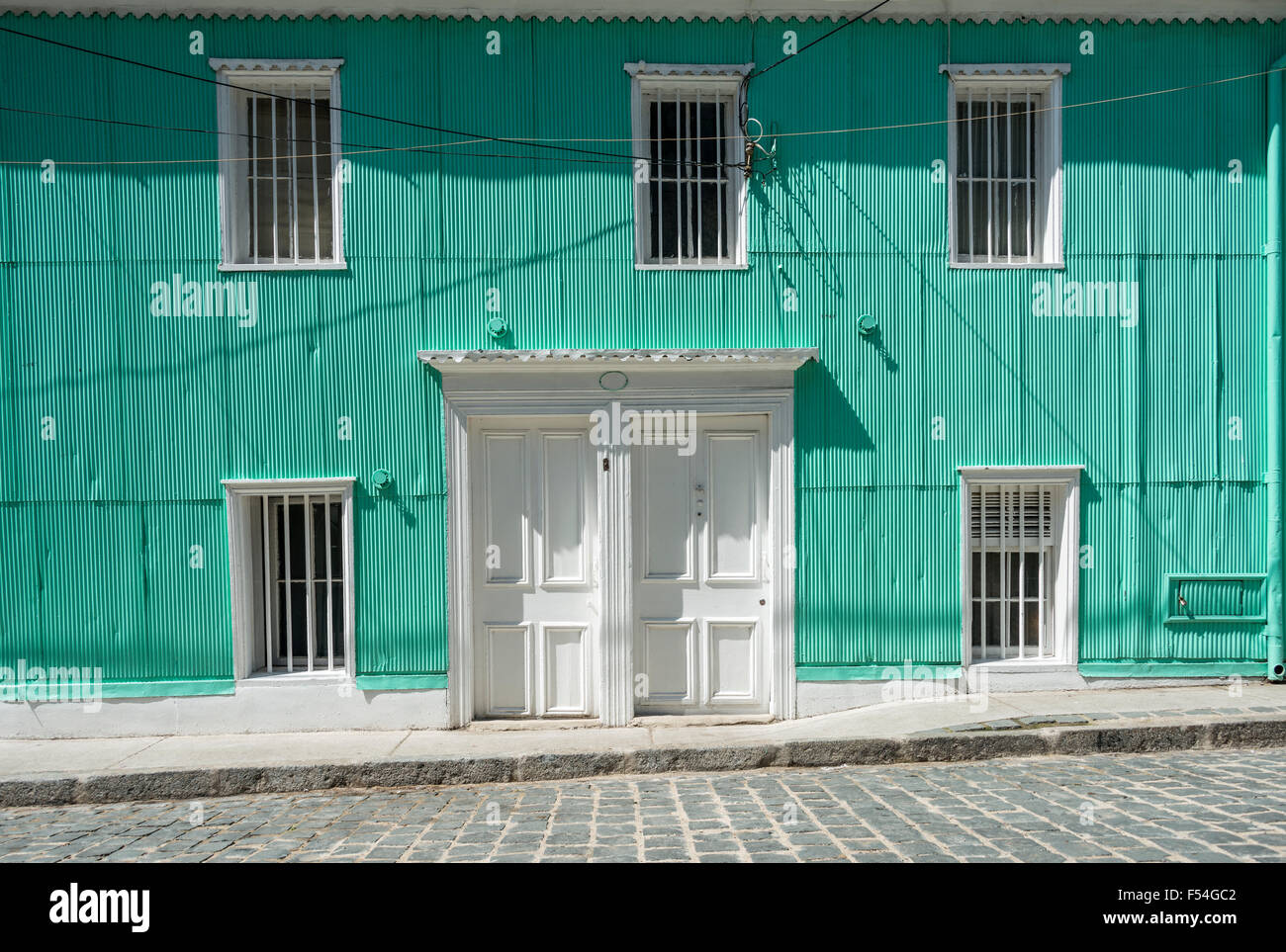 Typical zinc faсade of the houses in Valparaiso, Chile - Stock Image