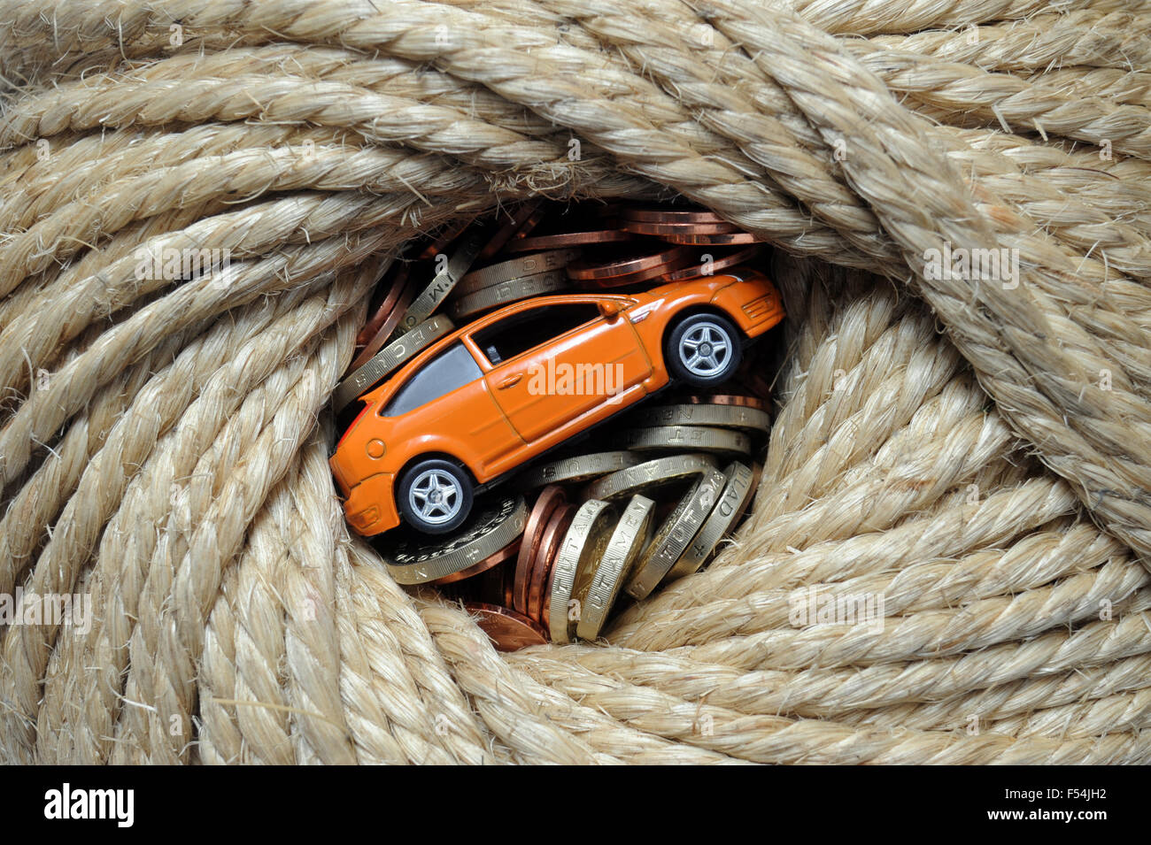 MODEL CAR WRAPPED IN ROPE WITH MONEY RE CARS MOTORING COSTS PRICES ...