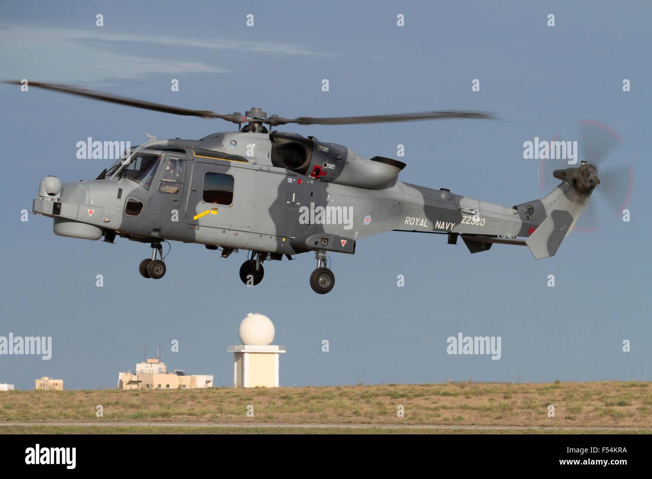 AgustaWestland AW159 Wildcat HMA2 military helicopter of Britain's Royal Navy hovering in the air - Stock Image