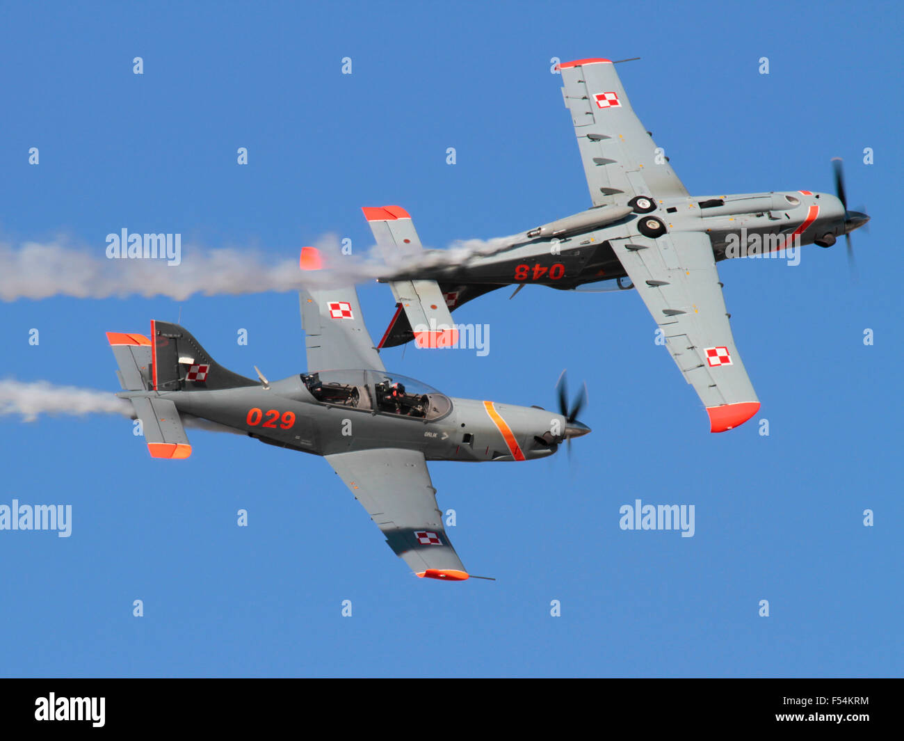 PZL-130 Orlik trainer aircraft of the Polish Air Force flying in formation during an air display - Stock Image