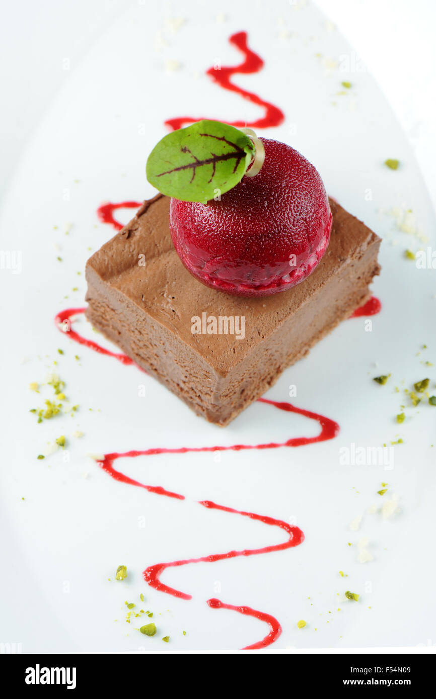 Gourmet chocolate mouse ice cream dessert with a dark cherry sorbet. - Stock Image