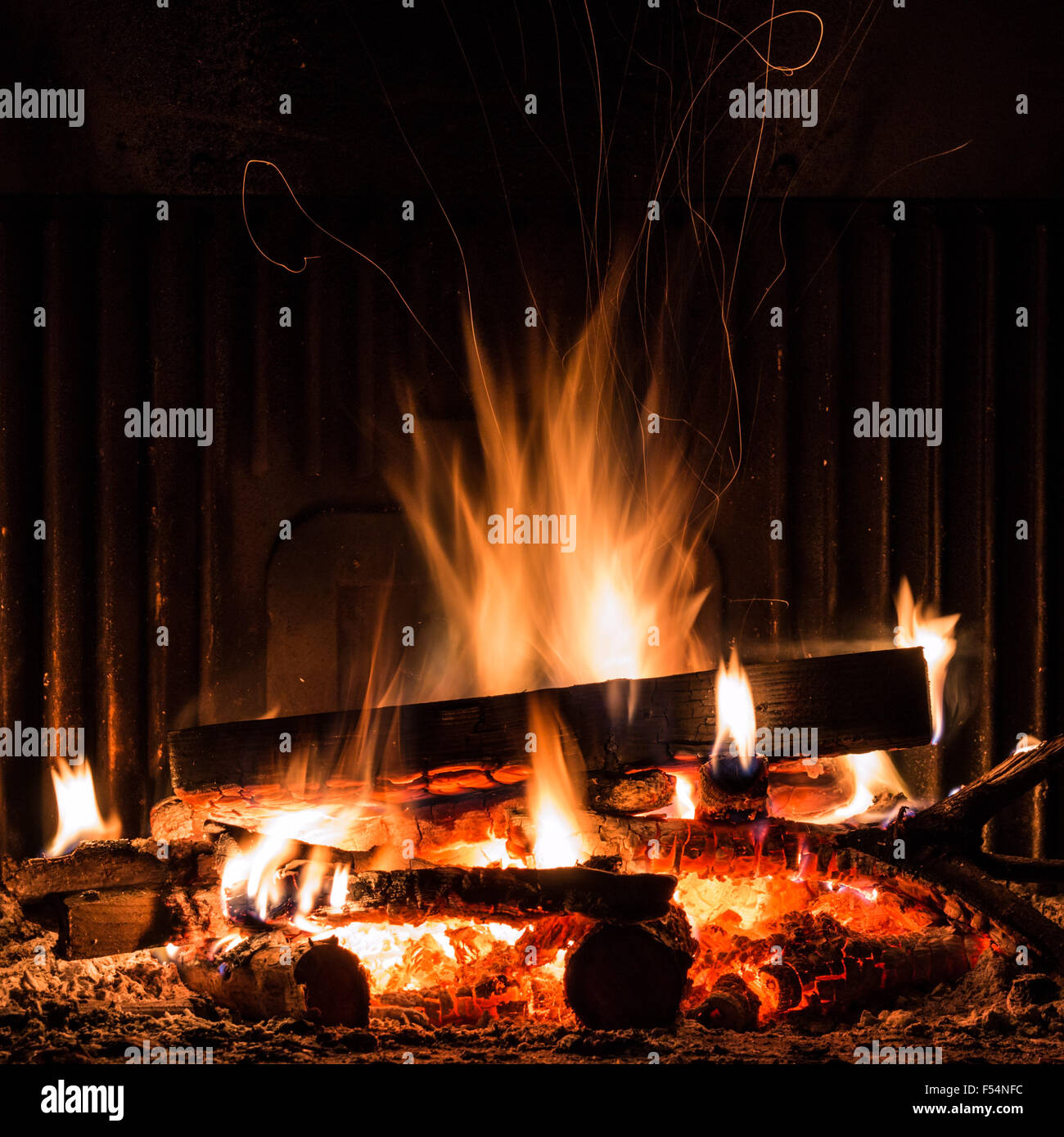Fireplace with blazing flames, view of the fire - Stock Image