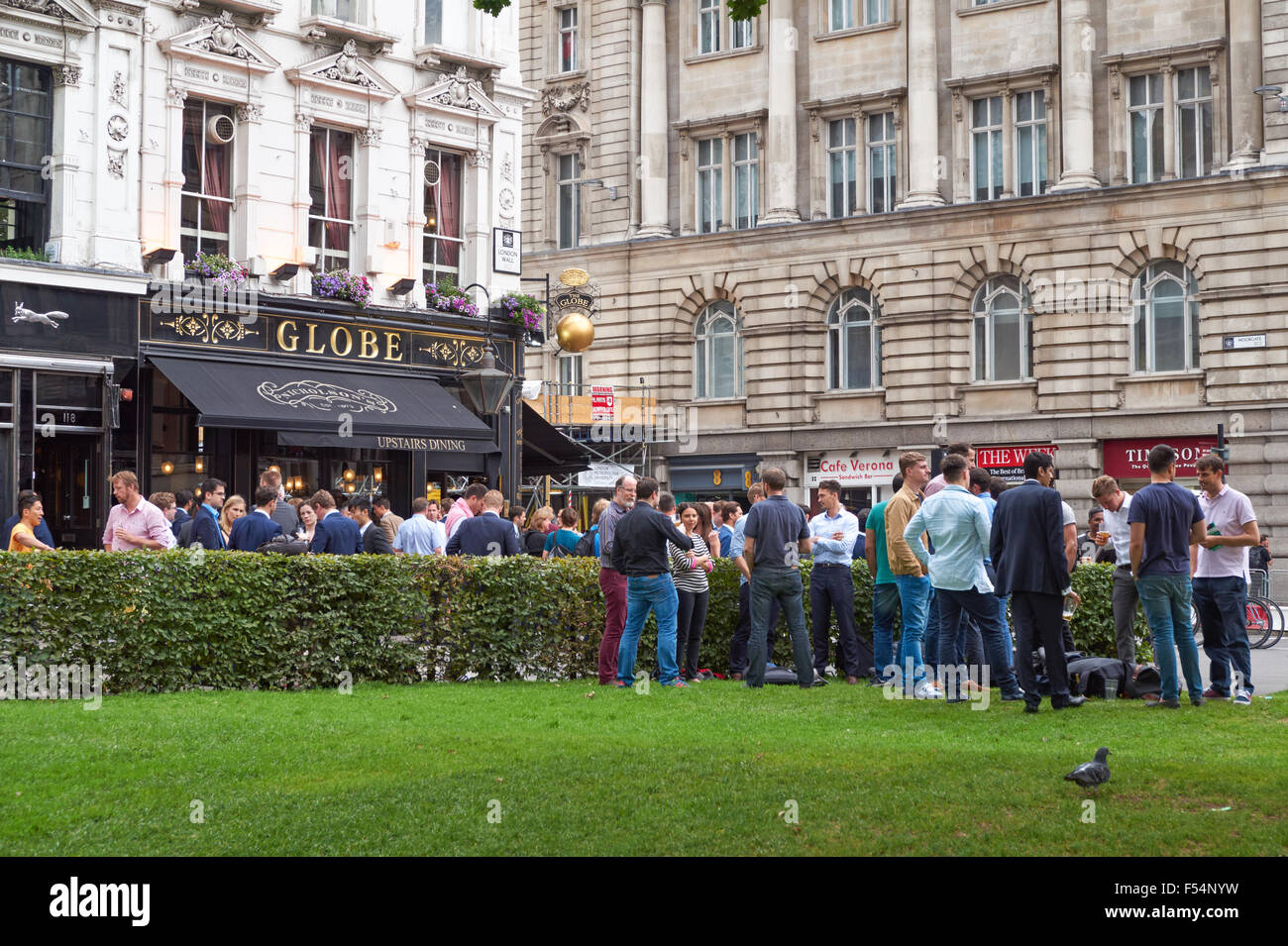 People drinking outside The Globe pub in London England United Kingdom UK Stock Photo