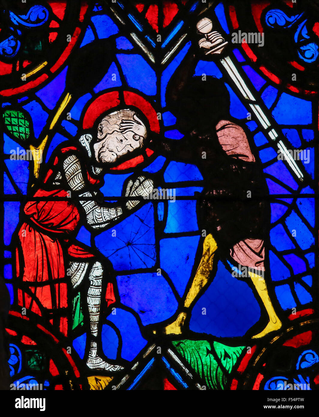 Stained glass window depicting the execution of a martyr in the Saint Gatien Cathedral of Tours, France. - Stock Image