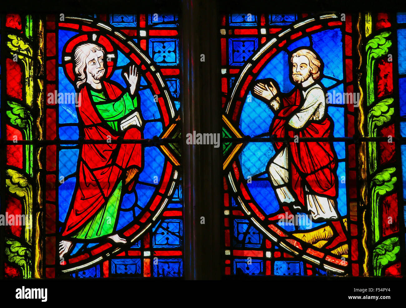 Stained glass window depicting Jesus and a Believer in the Cathedral of Tours, France. - Stock Image