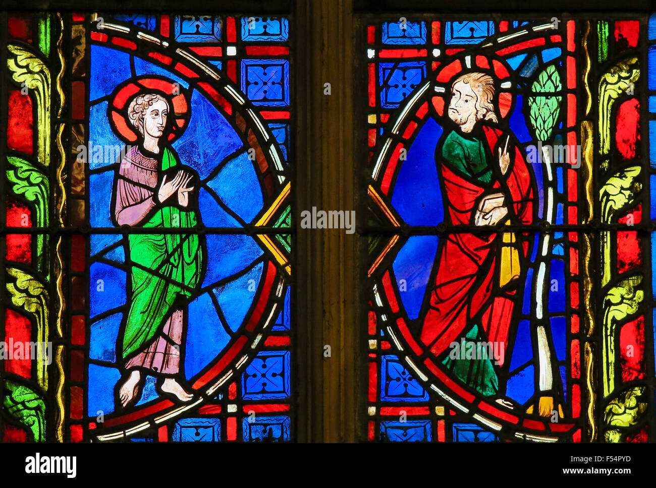 Stained glass window depicting Jesus and a Saint in the Cathedral of Tours, France. - Stock Image