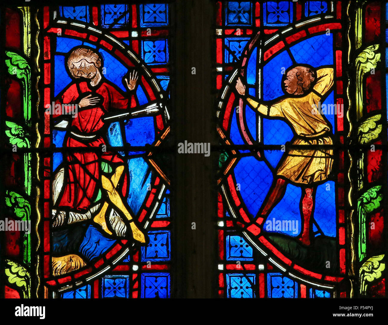 Stained glass window depicting a Saint killed by an arrow in the Cathedral of Tours, France. - Stock Image