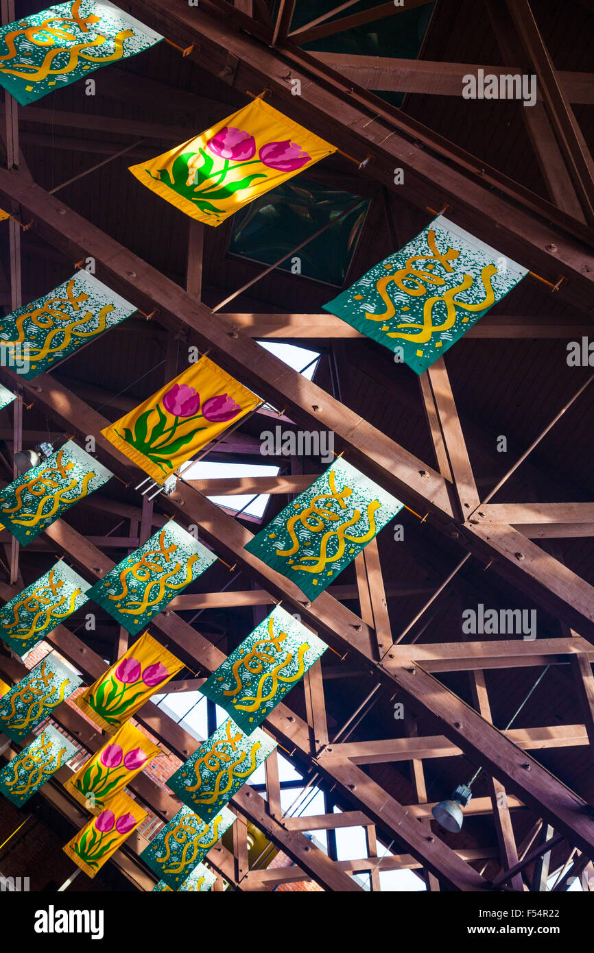Abstract images of roof trusses and banners in Market Square, Victoria, B.C. Canada - Stock Image