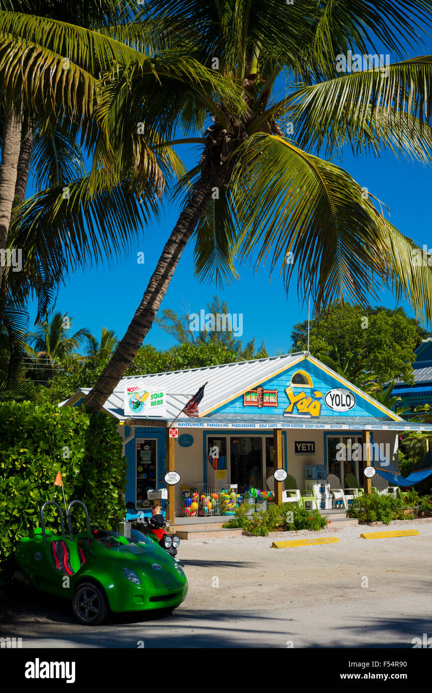 Souvenir and watersports equipment shop Yolo and palm trees in downtown Captiva Island in Florida, USA Stock Photo