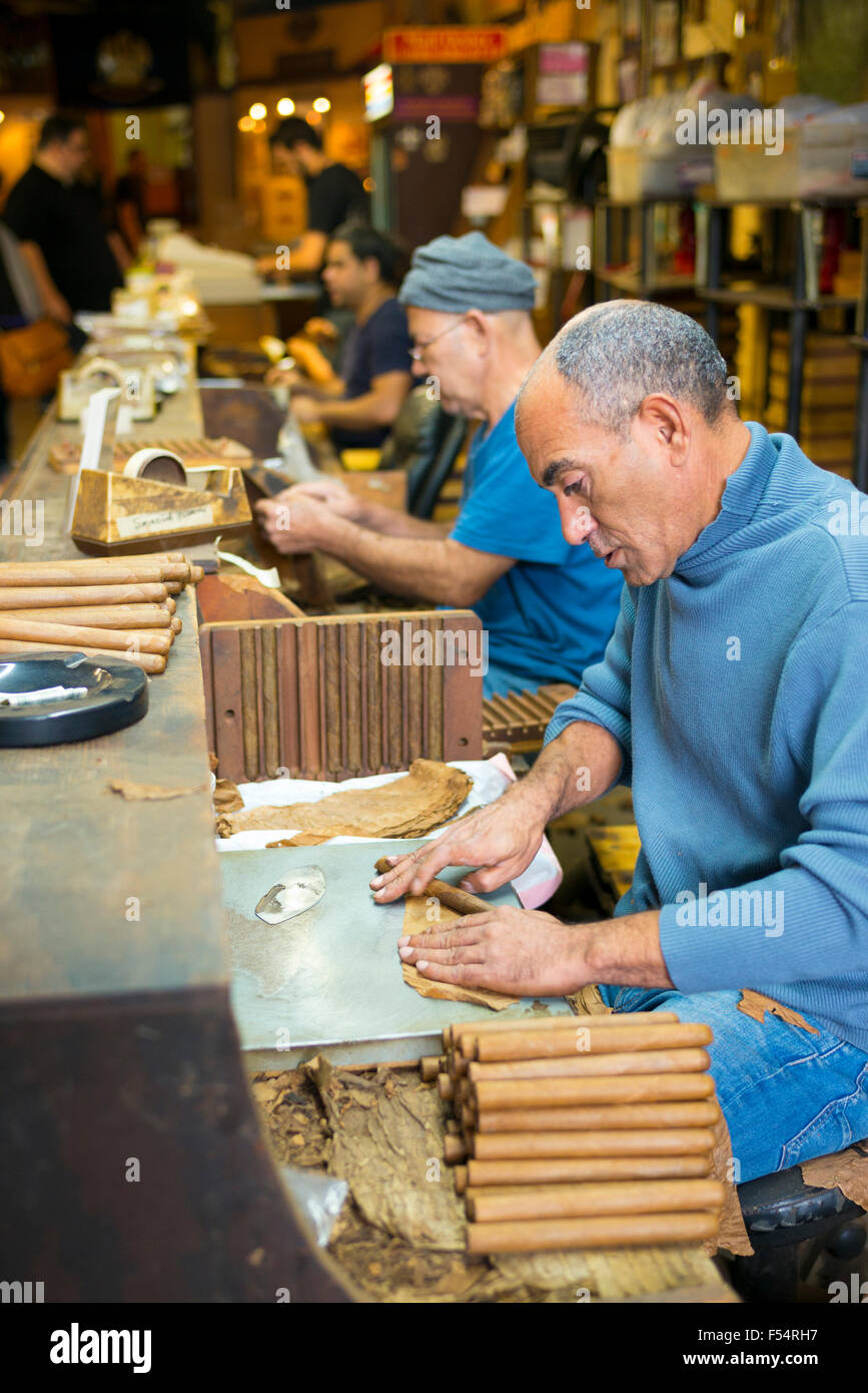 Rollers making hand-rolled cigars of long leaf tobacco in cigar