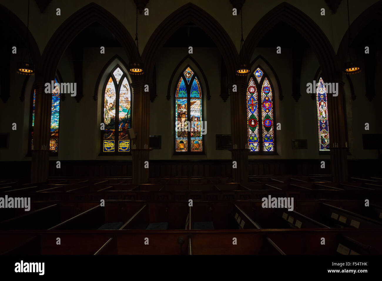 church interior stain glass windows - Stock Image