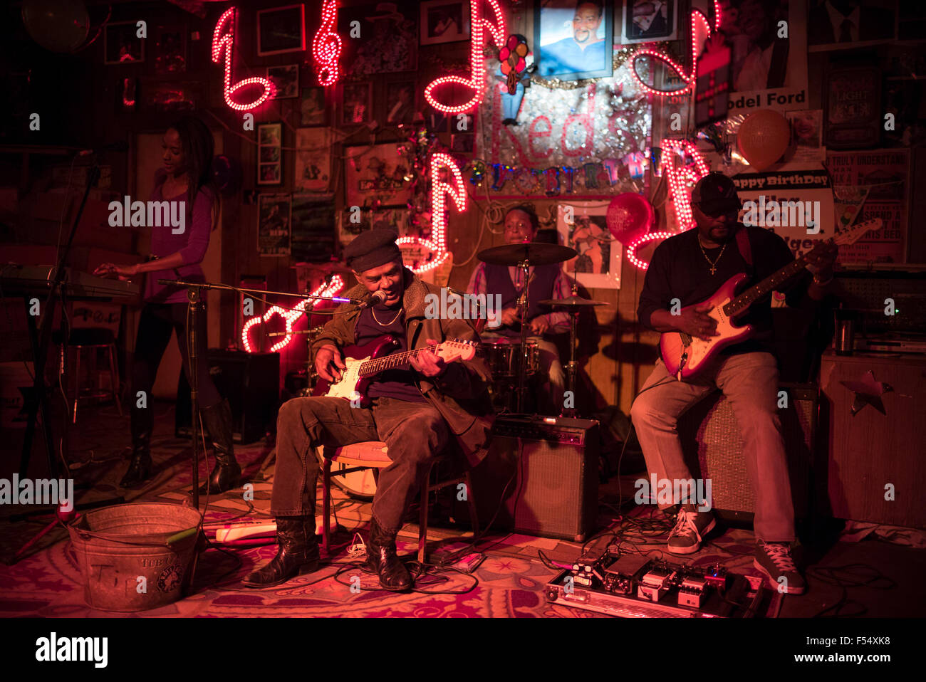 Blues band, guitarist, drums, vocals in live performance on stage at Red's Lounge Blues Club in Clarksdale, Mississippi, Stock Photo